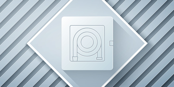 Paper cut Fire hose cabinet icon isolated on grey background. Paper art style. Vector Illustration