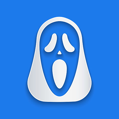 Paper cut Funny and scary ghost mask for Halloween icon isolated on blue background. Happy Halloween party. Paper art style. Vector