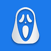 istock Paper cut Funny and scary ghost mask for Halloween icon isolated on blue background. Happy Halloween party. Paper art style. Vector 1271984142