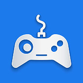 istock Paper cut Gamepad icon isolated on blue background. Game controller. Paper art style. Vector Illustration 1270644032