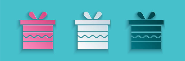 Paper cut Gift box icon isolated on blue background. Happy Birthday. Paper art style. Vector Illustration Paper cut Gift box icon isolated on blue background. Happy Birthday. Paper art style. Vector Illustration anniversary clipart stock illustrations