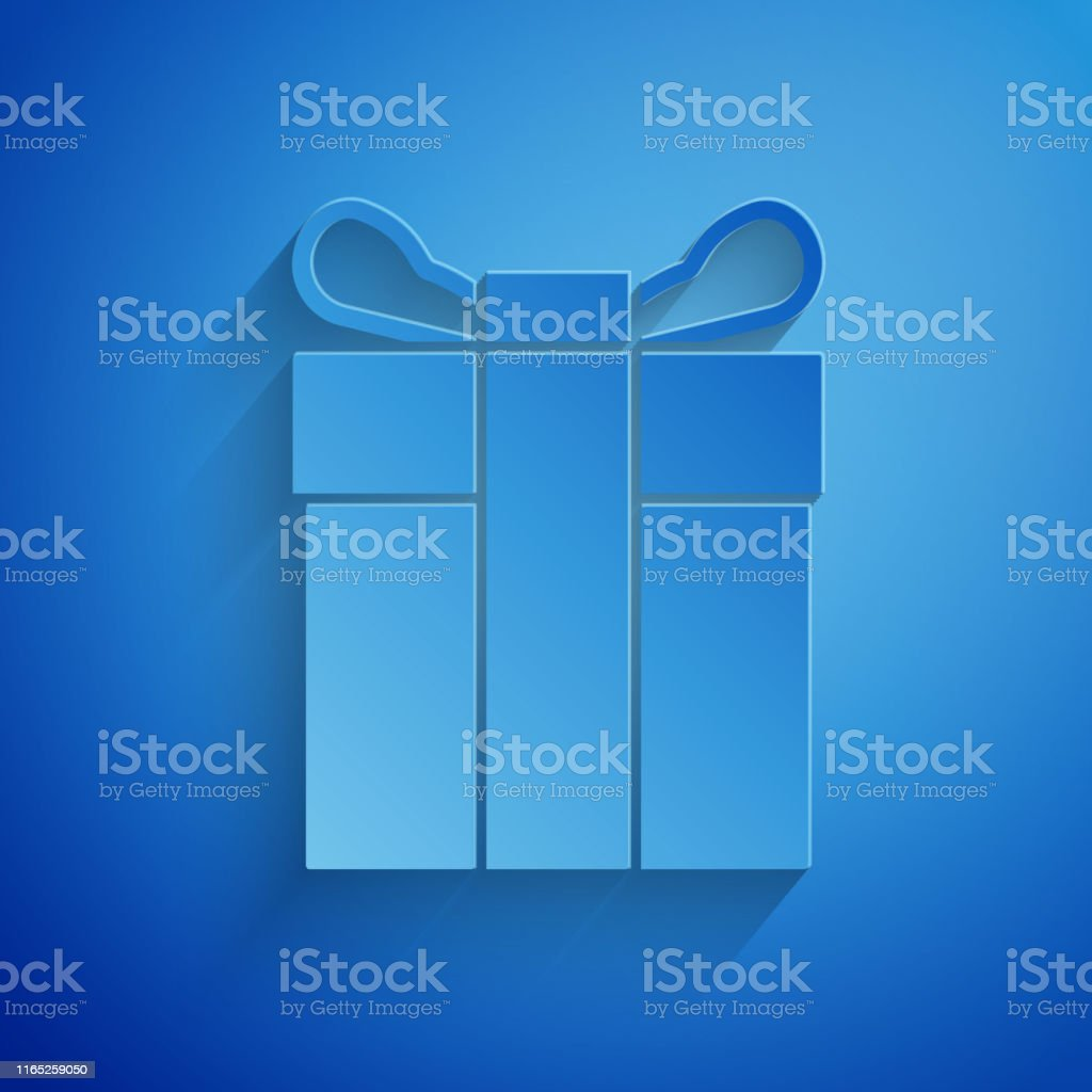 Paper cut Gift box icon isolated on blue background. Paper art style....