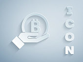istock Paper cut Hand holding Bitcoin icon isolated on grey background. Blockchain technology, digital money market, cryptocoin wallet. Paper art style. Vector 1279529944
