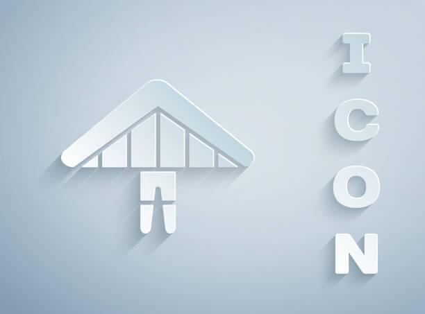 ilustrações, clipart, desenhos animados e ícones de papel cortado ícone do planador hang isolado no fundo cinza. esporte extremo. estilo de arte de papel. ilustração vetorial - ícones de design planar