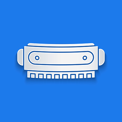 Paper cut Harmonica icon isolated on blue background. Musical instrument. Paper art style. Vector Illustration