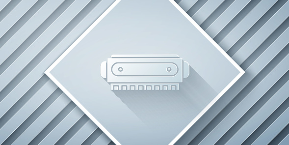 Paper cut Harmonica icon isolated on grey background. Musical instrument. Paper art style. Vector Illustration