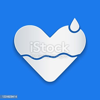 Paper cut Heart heal icon isolated on blue background. Paper art style. Vector Illustration