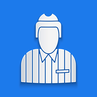 Paper cut Hockey judge, referee, arbiter icon isolated on blue background. Paper art style. Vector Illustration