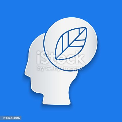 Paper cut Human head with leaf inside icon isolated on blue background. Paper art style. Vector Illustration
