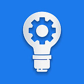 Paper cut Light bulb and gear icon isolated on blue background. Innovation concept. Business idea. Paper art style. Vector Illustration