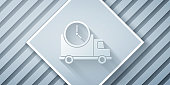 Paper cut Logistics delivery truck and clock icon isolated on grey background. Delivery time icon. Paper art style. Vector Illustration