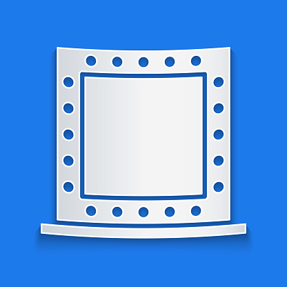 Paper cut Makeup mirror with lights icon isolated on blue background. Paper art style. Vector Illustration
