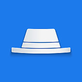 istock Paper cut Man hat with ribbon icon isolated on blue background. Paper art style. Vector Illustration 1254409267