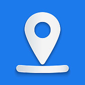 Paper cut Map pin icon isolated on blue background. Navigation, pointer, location, map, gps, direction, place, compass, search concept. Paper art style. Vector Illustration