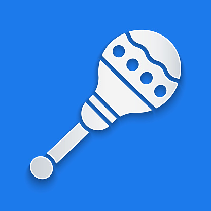Paper cut Maracas icon isolated on blue background. Music maracas instrument mexico. Paper art style. Vector Illustration
