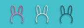 istock Paper cut Mask with long bunny ears icon isolated on blue background. Paper art style. Vector Illustration 1253642412