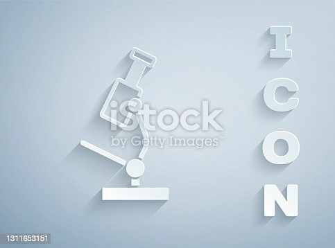 istock Paper cut Microscope icon isolated on grey background. Chemistry, pharmaceutical instrument, microbiology magnifying tool. Paper art style. Vector 1311653151