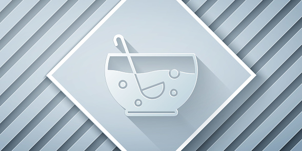 Paper cut Mixed punch with fresh fruits in bowl icon isolated on grey background. Paper art style. Vector Illustration
