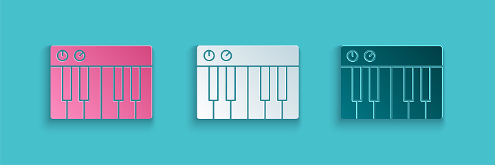 Paper cut Music synthesizer icon isolated on blue background. Electronic piano. Paper art style. Vector Illustration