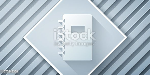 istock Paper cut Notebook icon isolated on grey background. Spiral notepad icon. School notebook. Writing pad. Diary for school. Paper art style. Vector Illustration 1270643358