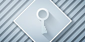 Paper cut Old key icon isolated on grey background. Paper art style. Vector Illustration
