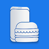istock Paper cut Online ordering and fast food delivery icon isolated on blue background. Burger sign. Paper art style. Vector Illustration 1266098284