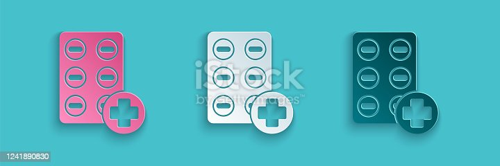 istock Paper cut Pills in blister pack icon isolated on blue background. Medical drug package for tablet, vitamin, antibiotic, aspirin. Paper art style. Vector Illustration 1241890830