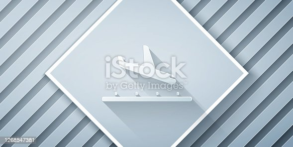 Paper cut Plane landing icon isolated on grey background. Airplane transport symbol. Paper art style. Vector Illustration