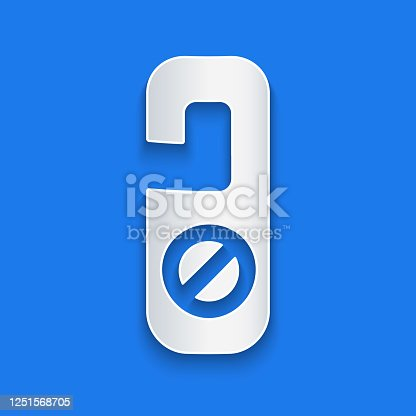 istock Paper cut Please do not disturb icon isolated on blue background. Hotel Door Hanger Tags. Paper art style. Vector Illustration 1251568705