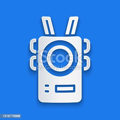 istock Paper cut Police body camera icon isolated on blue background. Paper art style. Vector 1316778988
