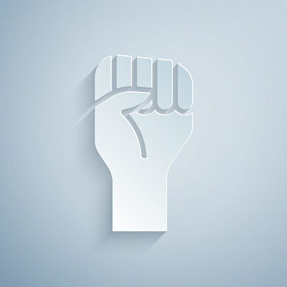 Paper cut Raised hand with clenched fist icon isolated on grey background. Protester raised fist at a political demonstration. Empowerment. Paper art style. Vector