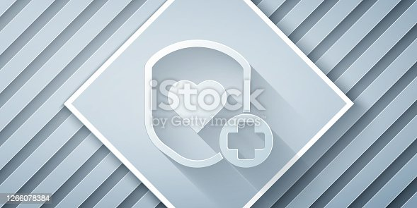 istock Paper cut Shield and heart rate icon isolated on grey background. Health protection concept. Health care. Paper art style. Vector Illustration 1266078384
