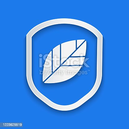 Paper cut Shield with leaf icon isolated on blue background. Eco-friendly security shield with leaf. Paper art style. Vector Illustration