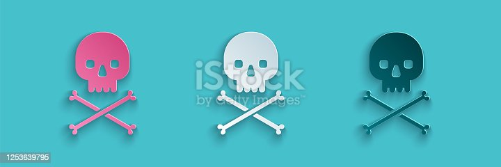 istock Paper cut Skull on crossbones icon isolated on blue background. Paper art style. Vector Illustration 1253639795