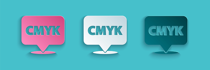 Paper cut Speech bubble with text CMYK icon isolated on blue background. Paper art style. Vector Illustration