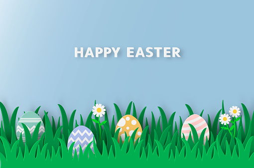 Paper cut style with easter egg in the grass