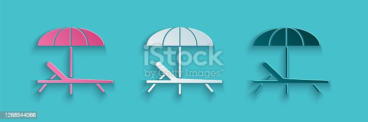 istock Paper cut Sunbed icon isolated on blue background. Beach umbrella and Sun lounger. Paper art style. Vector Illustration 1268544066