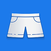 istock Paper cut Swimming trunks icon isolated on blue background. Paper art style. Vector Illustration 1268548334