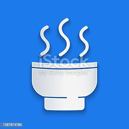 istock Paper cut Traditional Chinese tea ceremony icon isolated on blue background. Teapot with cup. Paper art style. Vector Illustration 1267674784