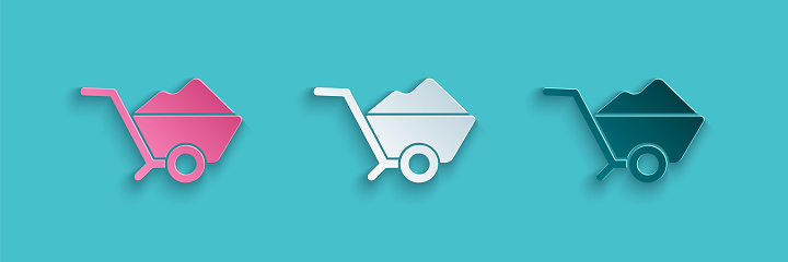 Paper cut Wheelbarrow with dirt icon isolated on blue background. Tool equipment. Agriculture cart wheel farm. Paper art style. Vector Illustration