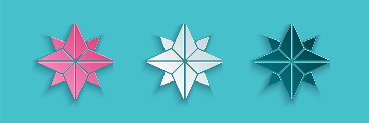 Paper cut Wind rose icon isolated on blue background. Compass icon for travel. Navigation design. Paper art style. Vector Illustration