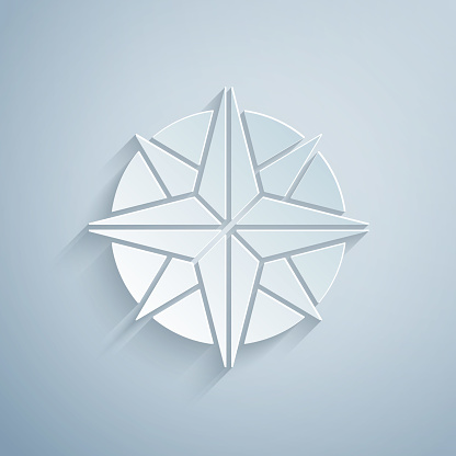 Paper cut Wind rose icon isolated on grey background. Compass icon for travel. Navigation design. Paper art style. Vector Illustration