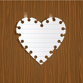 Paper heart on wooden background
