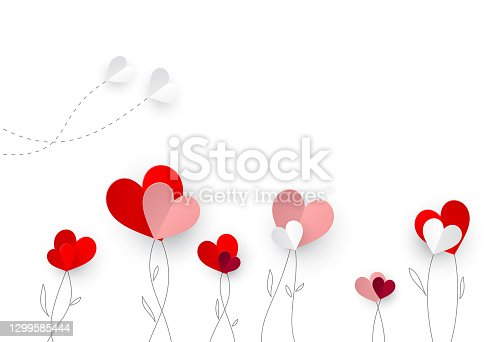 Paper hearts that looks like flowers and butterflies on top of hand-drawn branches on white background