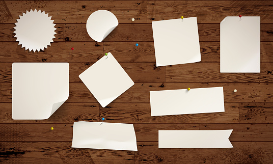 Paper notes on wooden background