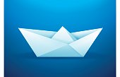 Paper origami sailboat blue background concept.