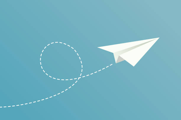 Paper plane flying A white paper plane flying, with dotted route line on blue background. paper airplane stock illustrations