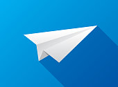 Vector illustration of a paper plane against a blue background in flat style.