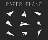 Paper planes different views on black background.