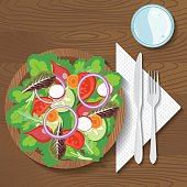 Paper Plate Of Food On A Wood Background. Fresh mixed salad.